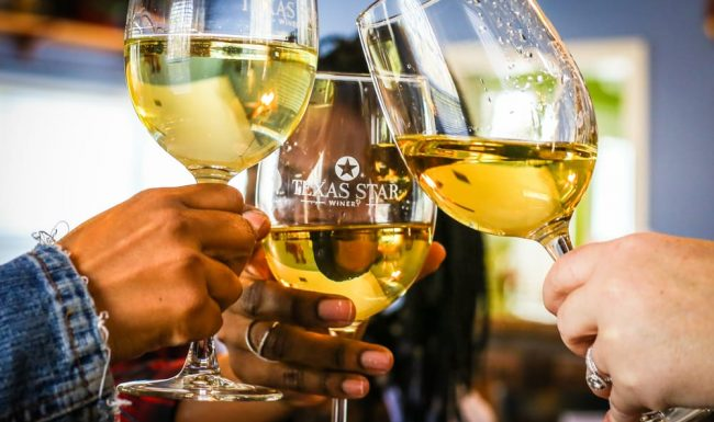 Toasting with three glasses of white wine